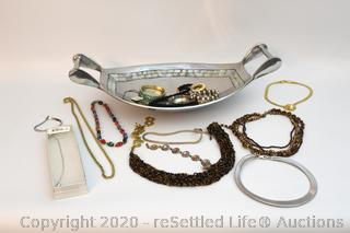 Silver Basket with an Array of Vintage and Modern Bracelets and Necklaces