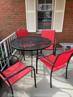 Black Wrought Iron Table with Four Chairs