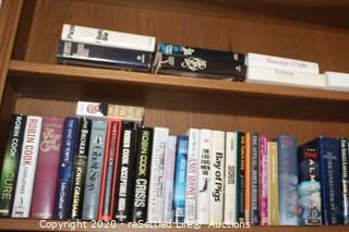 Two Shelves of Fiction Hardcover Books