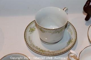 Teacups, Saucers and Clear Glass